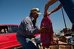 David Lee volunteers to distribute food in Crystal City, Texas. The San Antonio Food Bank makes monthly deliveries to Crystal City in Zavala County, Texas, which has the nation's highest rate of food insecurity. October 2, 2012. Copyright Lance Rosenfield / Prime