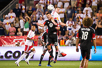 Perry Kitchen (23) of DC United and Kenny Cooper (33) of the New York Red Bulls go up for a header. The New York Red Bulls defeated DC United 3-2 during a Major League Soccer (MLS) match at Red Bull Arena in Harrison, NJ, on June 24, 2012.