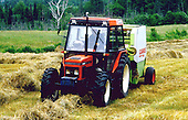 Bailing hay in field with a round baler