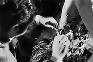 New York City. October, 1966. Paco Rabanne, fixing a dress while presenting his collection for the first time in NYC. He became known for using unconventional materials for his designs.