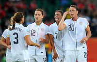 Christie Rampone, Lauren Cheney, Shannon Boxx and Abby Wambach (left to right) of team USA react during the FIFA Women's World Cup at the FIFA Stadium in Wolfsburg, Germany on July 6thd, 2011.