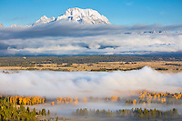 Teton National Park, Wyoming: Lingering fog in the Snake River valley with the Mount Moran in morning light