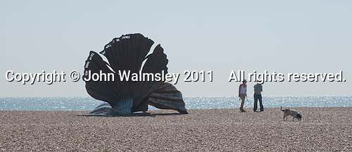 """""""Scallop"""" a sculpture to celebrate Benjamin Britten by Maggie Hambling.  Made specifically for this site on the Suffolk coast which inspired so much of Britten's music.  The phrase, """"I hear those voices that will not be drowned"""" (pierced through the steel against the sky), is taken from Britten's opera """"Peter Grimes"""", which was itself based on a work by the Aldeburgh poet, George Crabbe."""