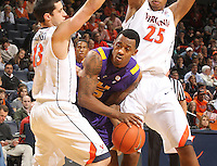 Jan. 2, 2011; Charlottesville, VA, USA; LSU Tigers forward Malcolm White (5) gets caught between Virginia Cavaliers guard Sammy Zeglinski (13) and Virginia Cavaliers forward Akil Mitchell (25) during the game at the John Paul Jones Arena. Mandatory Credit: Andrew Shurtleff-