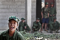 KIA female recruit laughs as she plays with her friends during a resting time from their basic military training program at one of the trainig camps outskirsts Laiza city, the headquarters of the Kachin Independence rebel Army. Since the begining of the Kachin uprising for its sovereignty women always fought by side the rebel soldiers, but officially, the female KIA was founded in 2007, since then, up to 1500 women have joint to the rebel army. The KIA is enhancing its troops number since the ceasefire was broken out by the Burmese army last June 2011. During months the fighting were spread out along the Kachin State leaving more than 40,000 displaced persons and refugees (a conservative estimating) in accord with the humanitarian aid groups.