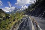 Motor cyclist, Alpine peak and forests. Hahntennjoch pass, Imst district, Tyrol, Tirol, Austria.