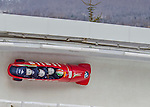 9 January 2016: Italian pilot Simone Bertazzo leads his 4-man team as they cruise through Curve 14 during their second run of the day at the BMW IBSF World Cup Bobsled Championships at the Olympic Sports Track in Lake Placid, New York, USA. Bertazzo's team came in 11th for the day, with a 2-run combined time of 1:50.99. Mandatory Credit: Ed Wolfstein Photo *** RAW (NEF) Image File Available ***