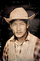 A young Ladakhi Man in the attire of a Cowboy... Not only he was dressed like a cowboy he had a number of horses to make his living... Taken in the village Korzok near Tso Moriri Lake in Changthang region of Ladakh...