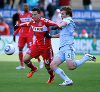 Sporting KC defender Matt Besler (5) prepares to slide tackle the ball away from Chicago Fire midfielder Marco Pappa (16).  The Chicago Fire defeated Sporting KC 3-2 at Toyota Park in Bridgeview, IL on March 27, 2011.