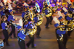Members of a local marching band make music as they entertain crowds for the Festival of Lights Parade.