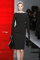Yulia walks runway in a ebony silk/wool long sleeved sheath dress with pocket details, from the Reem Acra Fall 2012 Feminine Power collection fashion show, during Mercedes-Benz Fashion Week New York Fall 2012 at Lincoln Center.