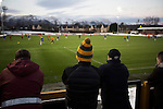 Alloa Athletic 0 Peterhead 1,14/01/2017. Recreation Park, Scottish League One. Home supporters watching the first-half action as Alloa Athletic take on Peterhead (in blue) in a Scottish League One fixture at Recreation Park, with the Ochil Hills in the background. The club was formed in 1878 as Clackmannan County, changing the name to Alloa Athletic in 1883. The visitors won the match by one goal to nil, watched by a crowd of 504. Photo by Colin McPherson.