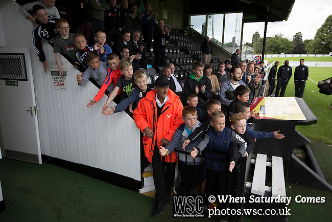 Elgin City 3 Edinburgh City 0, 13/08/2016. Borough Briggs, Scottish League Two. Young Elgin City fans waiting to applaud their team from the pitch at Borough Briggs, home to Elgin City, on the day they played SPFL2 newcomers Edinburgh City. Elgin City were a former Highland League club who were elected to the Scottish League in 2000, whereas Edinburgh City became the first club to gain promotion to the League by winning the Lowland League title and subsequent play-off matches in 2015-16. This match, Edinburgh City's first away Scottish League match since 1949, ended in a 3-0 defeat, watched by a crowd of 610. Photo by Colin McPherson.