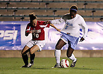 Maryland's Amanda Paizs (20) grabs the jersey of UNC's Jaime Gilbert (5) while challenging for the ball on Wednesday, November 2nd, 2005 at SAS Stadium in Cary, North Carolina. The University of North Carolina Tarheels defeated the University of Maryland Terrapins 3-1 during their Atlantic Coast Conference Tournament Quarterfinal game.
