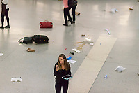 Personal items are strewn about after hundreds of people stampede out of Penn Station in New York on Friday, April 14, 2017 after an unfounded active shooter report.  (© Richard B. Levine)