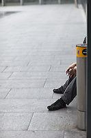 Smoking outdoors at London Heathrow Terminal 5. Smoking inside public buildings in the UK was made illegal in July 2007