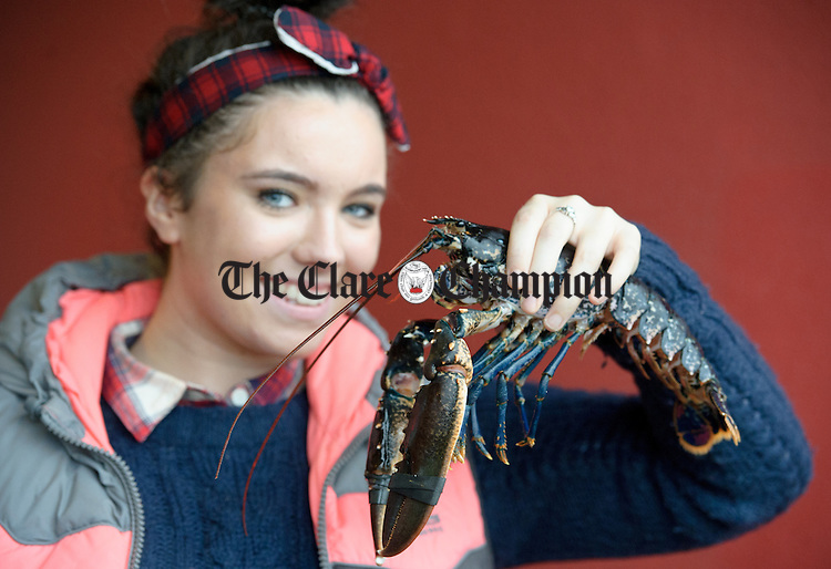 Amy Sweeney of Burren Sea Foods with a lobster during the Burren Food Fayre in the Pavilion, Lisdoonvarna as part of the Burren Winterage Weekend. Photograph by John Kelly.