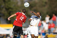 Louisville's Chase Rodgers (12) battles Akron's  Darlington Nagbe (6). 2010 NCAA D1 College Cup Championship Final Akron defeated Louisville 1-0 at Harder Stadium on the campus of UCSB in Santa Barbara, California on Sunday December 12, 2010.