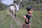A girl leads her horse in Victoria 20 de enero, a village of former Guatemalan refugees in Mexico who returned home as a group in 1993, while the country's bloody civil war still raged.