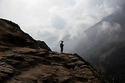 An Indian soldier patrols and provides security along the Amarnath trekking route in Kashmir, India. Hindu pilgrims brave sub zero temperature and high latitude passes and make their pilgrimage to reach the sacred Amarnath cave, which houses a lingam - a stylized phallus, worshiped by Hindus as a symbol of God Shiva. Photo: Sanjit Das/Panos