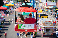 A couple enjoys the view from the Sky Glider high over the midway at the Ohio State Fair in Columbus, Ohio.