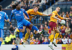 Motherwell v St Johnstone.....16.04.11  Scottish Cup Semi-Final.Collin Samuel in aerial tussle with Shaun Hutchison.Picture by Graeme Hart..Copyright Perthshire Picture Agency.Tel: 01738 623350  Mobile: 07990 594431