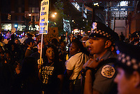 Police briefly surrounded by Black Lives Matter protesters in the South Loop while they tried unsuccessful to disperse the crowd in Chicago, Illinois on July 9, 2016.  Protests erupted nationwide following the police shootings of Alton Sterling who was selling bootleg DVDs outside a convenience store in Baton Rouge, Louisiana and Philando Castile during a routine traffic stop for a broken tail light in the St. Paul, Minneapolis suburb of Falcon Heights; on Thursday night, a lone gunman Micah Johnson fired and killed five police officers and injured several others during a Black Lives Matter protest in Dallas.