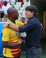 Ghana coach James Appiah shakes hands with Germany coach Joachim Loew before kick off