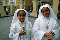 First Communion for sisters Kathia Lizeth Humala Marin and Lineth Estefani Humala Marin outside Iglesia San Pedro.  The Sunday celebration took place off the Plaza de Armas in LIma. <br /> Founded by Francisco Pizarro in 1535, the city is located along the desert coast in the center of Peru.  After a disastrous 1746 earthquake, Spanish colonial buildings were built in the period following.  In the Plaza de Armas area the colonial buildings have been repainted, balconies refurbished.
