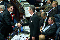 TALLAHASSEE, FLA. 3/5/13-OPENING030513CH-Rep. Jim Boyd, R-Bradenton, right, is congratulated by Rep. Doc Renuart, R- Ponte Vedra Beach, left, after the election overhaul bill passed the House on the opening day of the 2013 legislative session Tuesday at the Capitol in Tallahassee, Fla...COLIN HACKLEY PHOTO