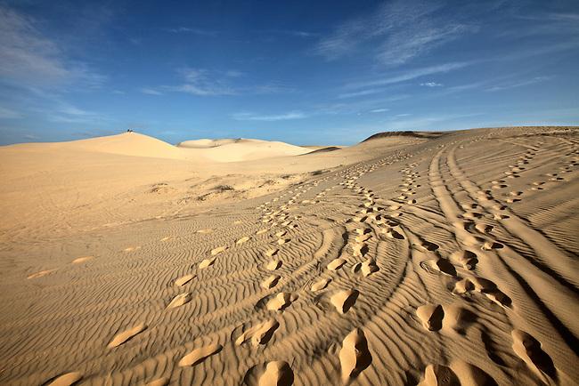 Footprints and ATV tracks crisscross the white dunes, about 30 kilometers north of Mui Ne, Vietnam. Nov. 16, 2011.