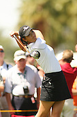 March 26, 2005; Rancho Mirage, CA, USA;  15 year old amateur Michelle Wie tees off at the 12th hole during the 3rd round of the LPGA Kraft Nabisco golf tournament held at Mission Hills Country Club.  Wie shot a 1 over par 73 for the day and was tied for 21st at one over par 217.<br />