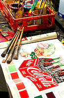Seventy-two-old Coca-Cola mural painter Andy Thompson, has painted thousands of murals in his 54-years  of working for Coca-Cola. Thompson who started as a painter is now a restorer of the iconic wall murals and advertisements. Thompson was doing some touch-up work on the mural in downtown, Concord, NC.<br /> <br /> Detail shot of the design book issued by Coca-Cola Company for painted walls and bulletins. The book is a field guide for Thompson to reference as he restores the iconic murals.<br /> <br /> Photo by: PatrickSchneiderPhoto,com