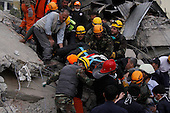 ERCIS, TURKEY: Rescue workers take an earthquake survivor to an ambulance...On October 23, 2011, a 7.2 magnitude earthquake hit eastern Turkey killing over 250 people and wounding over a thousand...Photo by Ali Arkady/Metrography