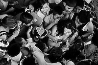 """A female Lucha libre wrestler Sahori struggles through the crowd of kids asking for an autograph after the performance at a local arena in Mexico City, Mexico, 30 April 2011. Lucha libre, literally """"free fight"""" in Spanish, is a unique Mexican sporting event and cultural phenomenon. Based on aerial acrobatics, rapid holds and the use of mysterious masks, Lucha libre features the wrestlers as fictional characters (Good vs. Evil). Women wrestlers, known as luchadoras, often wear bright shiny leotards, black pantyhose or other provocative costumes. Given the popularity of Lucha libre in Mexico, many wrestlers have reached the cult status, showing up in movies or TV shows. However, almost all female fighters are amateur part-time wrestlers or housewives. Passing through the dirty remote areas in the peripheries, listening to the obscene screams from the mainly male audience, these no-name luchadoras fight straight on the street and charge about 10 US dollars for a show. Still, most of the young luchadoras train hard and wrestle virtually anywhere dreaming to escape from the poverty and to become a star worshipped by the modern Mexican society."""