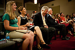 GOP Presidential candidate Rep. Michele Bachmann, center, attends the New Life Community Church congregation with her daughter, Sophia Bachmann, left, and husband Marcus, right,  in Marion, Iowa, July 24, 2011.