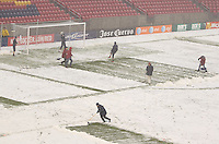 Crews work to remove snow from the field before the Women's USA Mexico match at Rio Tinto Stadium March 31, 2010 in Salt Lake City, Utah. The USA women won the match over Mexico 1-0.