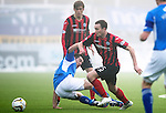 Queen of the South v St Johnstone...07.02.15    Scottish Cup 5th Round<br /> Chris Kane evades a challenge from Michael Paton<br /> Picture by Graeme Hart.<br /> Copyright Perthshire Picture Agency<br /> Tel: 01738 623350  Mobile: 07990 594431
