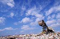 garbage truck dumping trash in landfill; NR. Olathe Kansas, Kanasas City area.