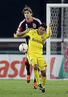 WASHINGTON, DC - OCTOBER 20, 2012:  Dejan Jakovic (5) of D.C United blocks Jairo Arrieta (25) of the Columbus Crew during an MLS match at RFK Stadium in Washington D.C. on October 20. D.C United won 3-2.