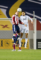 CARSON, CA - March 17, 2012: Chivas USA forward Casey Townsend (14) and Vancouver Whitecaps FC midfielder Jun Marques Davidson (27) during the Chivas USA vs Vancouver Whitecaps FC match at the Home Depot Center in Carson, California. Final score Vancouver Whitecaps 1, Chivas USA 0.