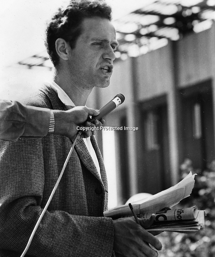 Mario Savio with a KPFA microphone speaking at a Free Speech rally in Sproul Plaza UC.Berkeley in 1964.(photo by Ron Riesterer/Oakland Tribune)