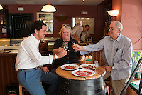 Sam and Jeannie Chesterton enjoying a glass of sherry and jamon iberico in a local bar