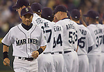 Seattle Mariners right fielder Ichiro Suzuki, of Japan, walks to home plate during opening ceremonies before the opening home game of the season with the Oakland Athletics at SAFECO Field in Seattle April 12, 2010.  During pregame ceremonies, Suzuki received his 9th consecutive Golden Glove and his  third Silver Slugger Awards. The Mariners open a three-game homestand against the Oakland Athletics.  Jim Bryant Photo. &copy;2010. ALL RIGHTS RESERVED.