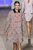 Maria Bradley walks the runway in a pink/green glen plaid bonded cotton coat, and pink/green glen plaid silk long-sleeved t-shirt dress, by Tommy Hilfiger for the Tommy Hilfiger Spring 2012 Pop Prep Collection, during Mercedes-Benz Fashion Week Spring 2012.