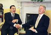 United States President Bill Clinton laughs with President Hosni Mubarak of Egypt (L) during their meeting in the Oval office of the White House, July 1, 1999.    .Credit: Richard Ellis / Pool via CNP