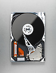 Open computer hard disk drive HDD isolated on metallic background