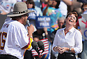 Republican Vice Presidential Candidate and Alaska Governor Sarah Palin laughs as singer Hank Williams Jr. sings to her during a rally at the Richmond International Raceway in Richmond, Virginia USA, on 13 October 2008. Palin and her running mate Senator John McCain are behind in many national voter polls.