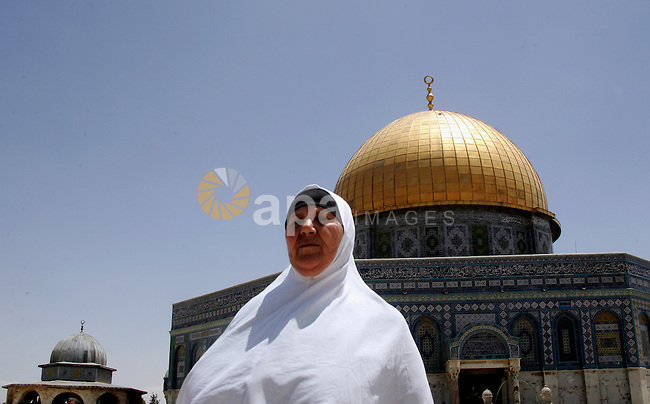 Palestinian Muslim woman walks in front of the Dome of Rock after Friday prayers in the Al Aqsa Mosque compound, also known to Jews as the Temple Mount, in Jerusalem's old city on May 28, 2010. Photo by Mahfouz Abu Turk