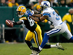 Green Bay's Donald Driver drops a Brett Favre pass on 3rd and 2-yards in the 1st quarter. He was defended by Detroit's Dre' Bly..The Green Bay Packers hosted the Detroit Lions at Lambeau Field Sunday, December 12, 2004. WSJ/Steve Apps.